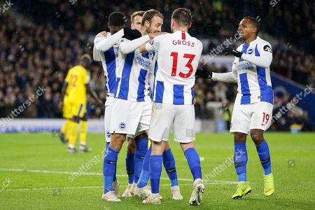 Brighton and Hove Albion midfielder Pascal Gross (13) congratulates Brighton and Hove Albion striker Glenn Murray (17) after his goal with Brighton and Hove Albion midfielder Jose Izquierdo (19) during the Premier League match between Brighton and Hove Albion and Crystal Palace at the American Express Community Stadium, Brighton and Hove