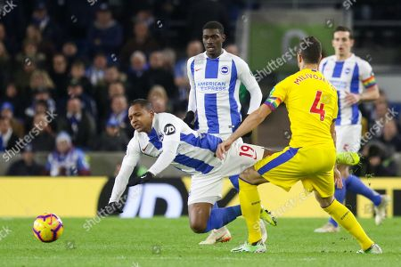Brighton and Hove Albion midfielder Jose Izquierdo (19) is tackled by Crystal Palace #4 Luka Milivojevic during the Premier League match between Brighton and Hove Albion and Crystal Palace at the American Express Community Stadium, Brighton and Hove