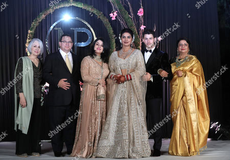 Newlyweds, Bollywood actress Priyanka Chopra (3-R) and US musician Nick Jonas (2-R) pose for photographs with family members, the bride's mother Madhu Chopra (R), the groom's father Paul Kevin Jonas Sr. (2-L), mother Denise Miller Jonas (3-L) and grandmother Frances Madonia-Miller (L) during a reception in New Delhi, India, 04 December 2018. According to media reports, the couple hosted wedding celebrations in Jodphur on 01 and 02 December.