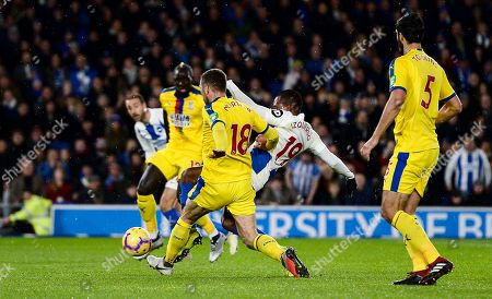 Jose Izquierdo of Brighton and Hove Albion is fouled by James McArthur of Crystal Palace which leads to a penalty