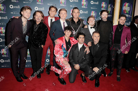 Mark Owen, Robbie Williams, Gary Barlow and Howard Donald of Take That with the cast of The Band