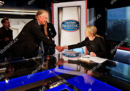 Dan Quayle, Dana Perino. Fox News contributor and Host of the Daily Briefing, Dana Perino, right, shakes hands with former Vice President Dan Quayle, left, before the start of an interview at Fox Studios in Washington