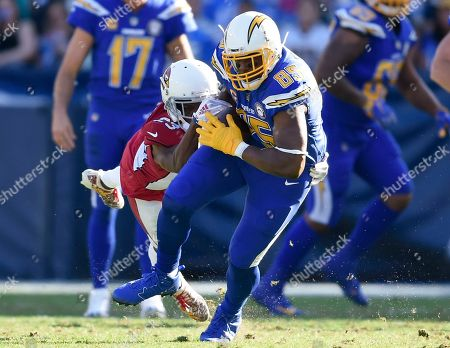 Antonio Gates, Bene' Benwikere. Los Angeles Chargers tight end Antonio Gates, right, runs after a catch as Arizona Cardinals cornerback Bene' Benwikere defends during the first half of an NFL football game, in Carson, Calif