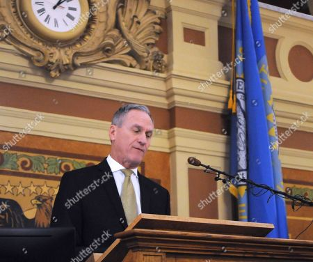 Gov. Dennis Daugaard gives the final budget address governor at the state Capitol in Pierre, S.D., . Daugaard is proposing spending increases for education, state employees and Medicaid providers in his plan