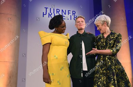 British artist Charlotte Prodger winner of the 2018 Turner Prize (C) poses with Nigerian author Chimamanda Ngozi Adichie (L) and Tate Britain Director Maria Balshaw (R) following her winners speech at the Tate Britain in London, Britain, 04 December 2018. The Turner Prize, which is presented since 1984 to a British-born or based artist aged under 50, is in its 34th year and is considered the highest award for arts in Britain.