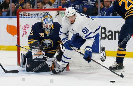 599532b85 Buffalo Sabres goalie Linus Ullmark (35) brings down Toronto Maple Leafs  forward John Travares ...