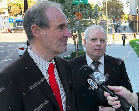 David Cassirer, right, and attorney David Boies talk about their federal court lawsuit to get back a classic painting, taken from Cassirer's great-grandmother, outside federal court in Los Angeles . Cassirer, the great-grandson of a Jewish woman who surrendered her priceless Camille Pissarro painting to escape the Holocaust watched Tuesday as his lawyer relentlessly grilled officials of the Spanish museum where it now hangs, expressing incredulity that they didn't know it was Nazi looted art