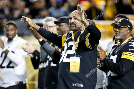 Former Pittsburgh Steelers running back Hall-of-Famer Franco Harris acknowldeges fans during a halftime ceremony honoring former Steelers players during halftime of the NFL football game between the Pittsburgh Steelers and the Los Angeles Chargers, in Pittsburgh