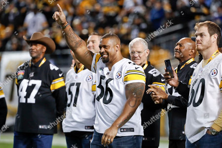 Stock Picture of Former Pittsburgh Steelers linebacker Lamarr Woodley acknowledges fans during a halftime ceremony honoring former Steelers players during halftime of the NFL football game between the Pittsburgh Steelers and the Los Angeles Chargers, in Pittsburgh