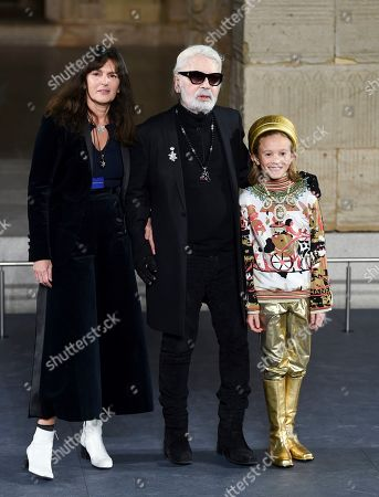 Karl Lagerfeld, Hudson Kroenig. Fashion designer Karl Lagerfeld, center, and godson Hudson Kroenig, right, walk the runway during finale of the Chanel Metiers d'Art 2018/19 Show at the Metropolitan Museum of Art, in New York