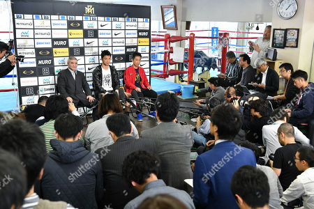 Ryota Murata of Japan, center, speaks with Tsuyoshi Hamada, left, and trainer Sendai Tanaka during the media conference at Teiken Boxing Gym Murata announced that he will continue his career.