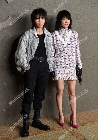 Stock Image of Leah Dou, Zhou Xun. Leah Dou, left, and Zhou Xun attend the Chanel Metiers d'Art 2018/19 Show at the Metropolitan Museum of Art, in New York