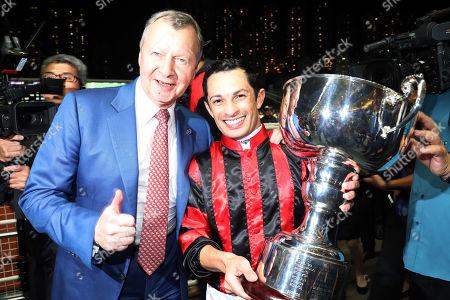 , Happy Valley, Hongkong, China, Winfried Engelbrecht-Bresges (left) congratulates jockey Silvestre de Sousa after winning the International Jockeys' Championship.