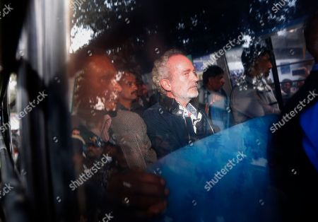 Christian James Michel, center, a British man accused of bribery in a $670 million helicopter deal between India and an Italian defense company returns after appearing before a Central Bureau of Investigation court in New Delhi, India, Wednesday, Dec.5, 2018. India's federal investigative agency said Tuesday that it extradited Michel from the United Arab Emirates to face charges of channeling money to Indian contacts