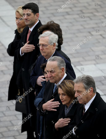 Congressional leaders (L-R) Speaker of the House Paul Ryan (R-WI), Senate Majority Leader Mitch McConnell (R-KY), Senate Minority Leader Chuck Schumer (D-NY) and House Minority Leader Nancy Pelosi (D-CA) watch as a US military honor guard team carries the flag draped casket of former US President George H. W. Bush from the US Capitol, Washington, DC, USA, 05 December 2018. eorge H. W. Bush, the 41st President of the United States (1989-1993), died in his Houston, Texas, USA, home surrounded by family and friends on 30 November 2018. The body will return to Houston for another funeral service before being transported by train to the George Bush Presidential Library and Museum for internment.