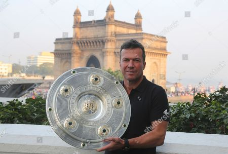 Former German Football player Lothar Matthaus poses for a photograph with Bundesliga trophy near the Gateway of India monument in Mumbai, India, . Matthaus is as part of the Bundesliga Legends Tour in India