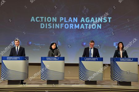 From left, European Commissioner for Digital Single Market Andrus Ansip, European Commissioner for Justice Vera Jourova, European Commissioner for Security Union Julian King and European Commissioner for Digital Economy Marija Gabriel participate in a media conference at EU headquarters in Brussels, . The European Commission on Wednesday reported on an Action Plan to counter disinformation and the progress achieved so far