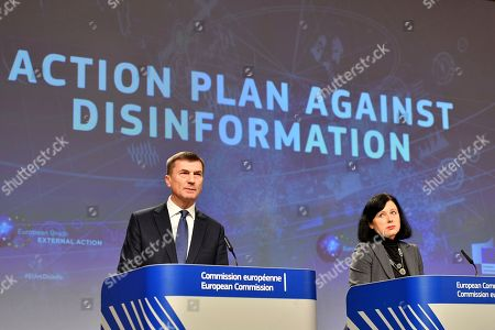 European Commissioner for Digital Single Market Andrus Ansip, left, and European Commissioner for Justice Vera Jourova participate in a media conference at EU headquarters in Brussels, . The European Commission on Wednesday reported on an Action Plan to counter disinformation and the progress achieved so far