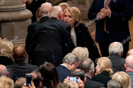 Former Secretary of State Hilary Clinton (R), greets former Vice President Joe Biden (L), before a State Funeral for former President George H.W. Bush at the National Cathedral, in Washington, DC, USA, 05 December 2018. George H.W. Bush, the 41st President of the United States (1989-1993), died at the age of 94 on 30 November 2018 at his home in Texas.