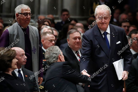 Former Canadian Prime Minister Brian Mulroney shakes hands with former President George W. Bush during the State Funeral for former President George H.W. Bush at the National Cathedral, in Washington, DC, USA, 05 December 2018. George H. W. Bush, the 41st President of the United States (1989-1993), died in his Houston, Texas, USA, home surrounded by family and friends on 30 November 2018. The body will return to Houston for another funeral service before being transported by train to the George Bush Presidential Library and Museum for internment.