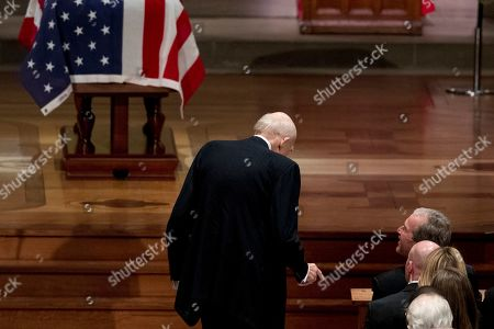 Former US Sen. Alan Simpson, R-Wyo, (C), speaks with former US President George W. Bush, right, as he walks to a podium to speak during the State Funeral for former President George H.W. Bush at the National Cathedral, in Washington, DC, USA, 05 December 2018. George H.W. Bush, the 41st President of the United States (1989-1993), died at the age of 94 on 30 November 2018 at his home in Texas.