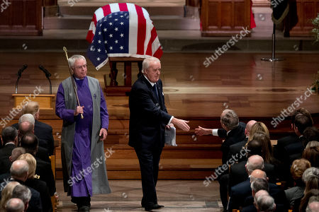Former Canadian Prime Minister Brian Mulroney (C), shakes hands with former US President George W. Bush (R), after speaking during the State Funeral for former President George H.W. Bush at the National Cathedral, in Washington, DC, USA, 05 December 2018. George H.W. Bush, the 41st President of the United States (1989-1993), died at the age of 94 on 30 November 2018 at his home in Texas.
