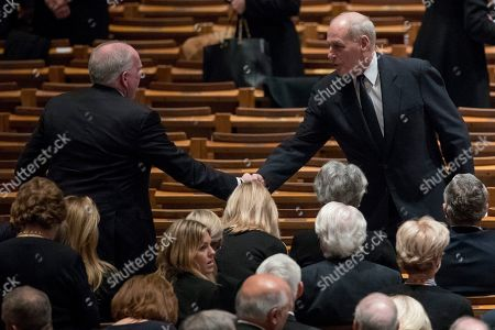 Former CIA Director John Brennan (L), shakes hands with President Donald Trump's Chief of Staff John Kelly (R), before a State Funeral for former President George H.W. Bush at the National Cathedral, in Washington, DC, USA, 05 December 2018. George H. W. Bush, the 41st President of the United States (1989-1993), died in his Houston, Texas, USA, home surrounded by family and friends on 30 November 2018. The body will return to Houston for another funeral service before being transported by train to the George Bush Presidential Library and Museum for internment.