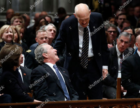 Former US senator Alan Simpson, R-Wyo, (R), speaks with former US President George W. Bush (C), as he walks to a podium to speak during the State Funeral for former President George H.W. Bush at the National Cathedral, in Washington, DC, USA, 05 December 2018. George H. W. Bush, the 41st President of the United States (1989-1993), died in his Houston, Texas, USA, home surrounded by family and friends on 30 November 2018. The body will return to Houston for another funeral service before being transported by train to the George Bush Presidential Library and Museum for internment.
