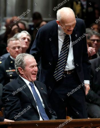 Former US Senator Alan Simpson, R-Wyo (R), speaks with former US President George W. Bush (L), as he walks to a podium to speak during the State Funeral for former US President George H.W. Bush at the National Cathedral, in Washington, DC, USA, 05 December 2018. George H.W. Bush, the 41st President of the United States (1989-1993), died in his Houston, Texas, USA, home surrounded by family and friends on 30 November 2018. The body will return to Houston for another funeral service before being transported by train to the George Bush Presidential Library and Museum for internment.