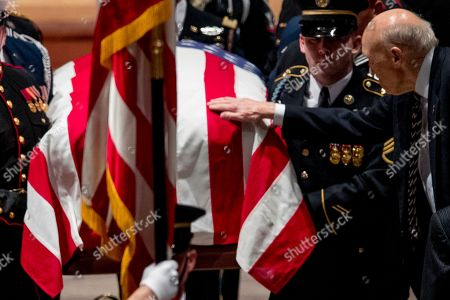 Former US Senator Alan Simpson, R-Wyo, touches the flag-draped casket of former US President George H.W. Bush as it is carried out by a military honor guard during a State Funeral at the National Cathedral, in Washington, DC, USA, 05 December 2018. George H.W. Bush, the 41st President of the United States (1989-1993), died at the age of 94 on 30 November 2018 at his home in Texas.