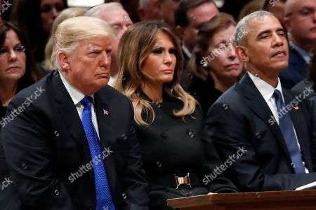 US President Donald Trump, first lady Melania Trump and former US President Barack Obama listen as former Canadian Prime Minister Brian Mulroney speaks during a State Funeral at the National Cathedral, in Washington, DC, USA, 05 December 2018. George H.W. Bush, the 41st President of the United States (1989-1993), died in his Houston, Texas, USA, home surrounded by family and friends on 30 November 2018. The body will return to Houston for another funeral service before being transported by train to the George Bush Presidential Library and Museum for internment.