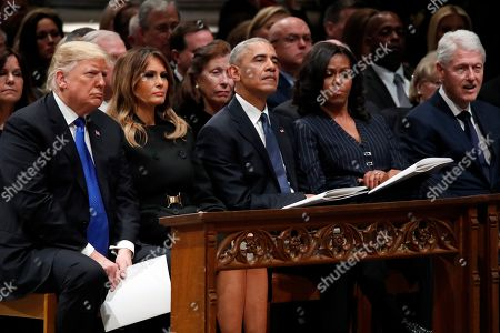 (L-R) US President Donald Trump, first lady Melania Trump, former US President Barack Obama, Michelle Obama and former US President Bill Clinton listen as former Canadian Prime Minister Brian Mulroney speaks during a State Funeral at the National Cathedral, in Washington, DC, USA, 05 December 2018. George H.W. Bush, the 41st President of the United States (1989-1993), died in his Houston, Texas, USA, home surrounded by family and friends on 30 November 2018. The body will return to Houston for another funeral service before being transported by train to the George Bush Presidential Library and Museum for internment.