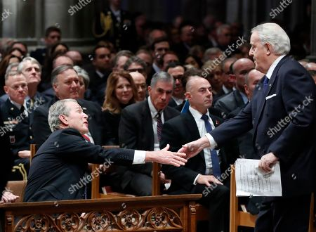 Former Canadian Prime Minister Brian Mulroney (R) shakes hands with former US President George W. Bush (L) after Mulroney gave a eulogy at the State Funeral for former President George H.W. Bush at the National Cathedral, in Washington, DC, USA, 05 December 2018. George H.W. Bush, the 41st President of the United States (1989-1993), died in his Houston, Texas, USA, home surrounded by family and friends on 30 November 2018. The body will return to Houston for another funeral service before being transported by train to the George Bush Presidential Library and Museum for internment.