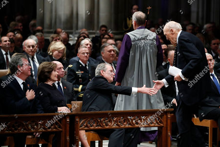 Former US President George W. Bush shakes hands with US Senator Alan Simpson (R), R-Wyo, after he spoke during the State Funeral for former President George H.W. Bush at the National Cathedral, in Washington, DC, USA, 05 December 2018. George H.W. Bush, the 41st President of the United States (1989-1993), died in his Houston, Texas, USA, home surrounded by family and friends on 30 November 2018. The body will return to Houston for another funeral service before being transported by train to the George Bush Presidential Library and Museum for internment.