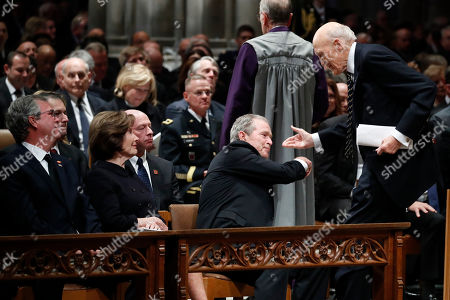 Former US President George W. Bush shakes hands with former Sen. Alan Simpson (R), R-Wyo, after he spoke during the State Funeral for former US President George H.W. Bush at the National Cathedral, in Washington, DC, USA, 05 December 2018. George H.W. Bush, the 41st President of the United States (1989-1993), died in his Houston, Texas, USA, home surrounded by family and friends on 30 November 2018. The body will return to Houston for another funeral service before being transported by train to the George Bush Presidential Library and Museum for internment.