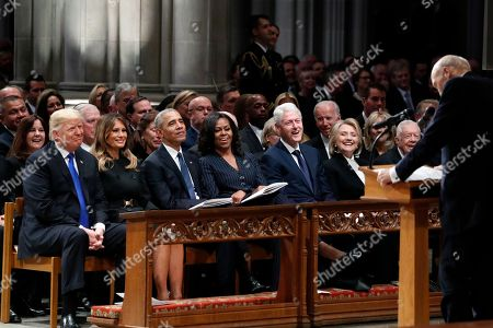 (L-R) US President Donald Trump, first lady Melania Trump, former President Barack Obama, Michelle Obama, former President Bill Clinton, former Secretary of State Hillary Clinton, and former President Jimmy Carter listen as former Sen. Alan Simpson, R-Wyo., speaks during a State Funeral at the National Cathedral, in Washington, DC, USA, 05 December 2018. George H.W. Bush, the 41st President of the United States (1989-1993), died in his Houston, Texas, USA, home surrounded by family and friends on 30 November 2018. The body will return to Houston for another funeral service before being transported by train to the George Bush Presidential Library and Museum for internment.