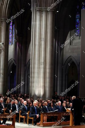 From left, US President Donald Trump, first lady Melania Trump, former President Barack Obama, Michelle Obama, former President Bill Clinton, former Secretary of State Hillary Clinton, and former President Jimmy Carter listen as former Sen. Alan Simpson, R-Wyo., speaks during a State Funeral at the National Cathedral, in Washington, DC, USA, 05 December 2018. George H.W. Bush, the 41st President of the United States (1989-1993), died in his Houston, Texas, USA, home surrounded by family and friends on 30 November 2018. The body will return to Houston for another funeral service before being transported by train to the George Bush Presidential Library and Museum for internment.