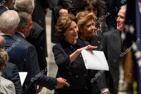 Former US Defense Secretary Leon Panetta, left, greets former President George Bush, right, as he and his wife, former first lady Laura Bush follow the flag-draped casket of former US President George H.W. Bush as it is carried out by a military honor guard during a State Funeral at the National Cathedral, in Washington, DC, USA, 05 December 2018. George H.W. Bush, the 41st President of the United States (1989-1993), died at the age of 94 on 30 November 2018 at his home in Texas.
