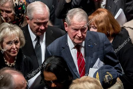 Former US Defense Secretary Robert Gates, center left, and former CIA Director William Webster, right, depart following the State Funeral for former US President George H.W. Bush at the National Cathedral, in Washington, DC, USA, 05 December 2018. George H.W. Bush, the 41st President of the United States (1989-1993), died at the age of 94 on 30 November 2018 at his home in Texas.