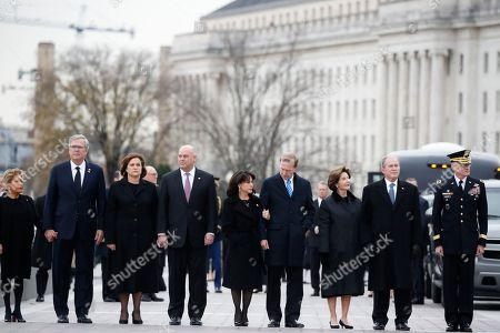 (R-L) former President George W. Bush, former first lady Laura Bush, Neil Bush, Sharon Bush, Bobby Koch, Doro Koch, Jeb Bush, and Columba Bush, stand just prior to the flag-draped casket of former President George H.W. Bush being carried by a joint services military honor guard from the US Capitol, in Washington, DC, USA, 05 December 2018. George H. W. Bush, the 41st President of the United States (1989-1993), died in his Houston, Texas, USA, home surrounded by family and friends on 30 November 2018. The body will return to Houston for another funeral service before being transported by train to the George Bush Presidential Library and Museum for internment.