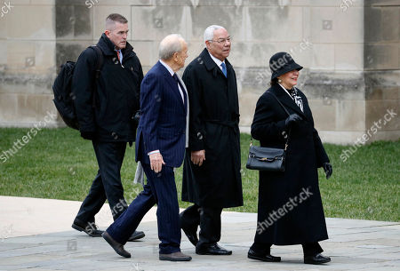Former Secretary of State Colin Powell, second from right, arrives at a State Funeral for former President George H.W. Bush at the National Cathedral, in Washington