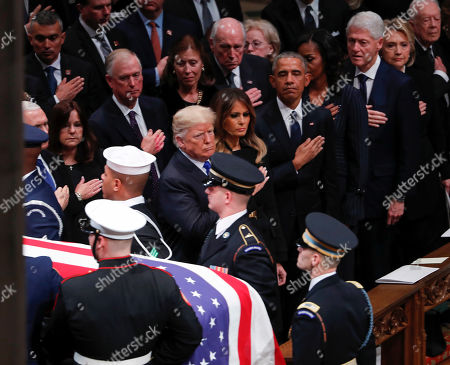 United States President Donald Trump (9R), First Lady Melania Trump (8R), along with Former United States President Barack Obama (5R), Former First Lady Michelle Obama (4R), Former United States President Bill Clinton (3R), Former Secretary of State Hillary Clinton (2R), and Former United States President Jimmy Carter (R), watch as a joint services military honor guard carries the casket of former United States President George H. W. Bush out following the funeral services at the National Cathedral in Washington, DC, USA, 05 December 2018. George H. W. Bush, the 41st President of the United States (1989-1993), died in his Houston, Texas, USA, home surrounded by family and friends on 30 November 2018. The body will return to Houston for another funeral service before being transported by train to the George Bush Presidential Library and Museum for internment.