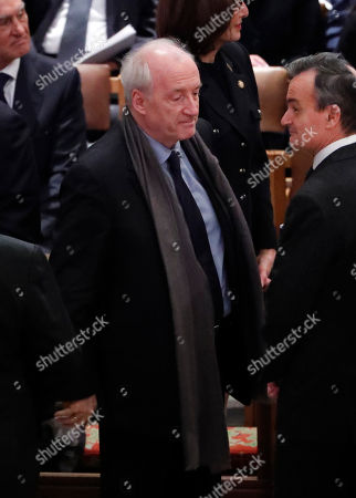 Former French foreign minister Hubert Vedrine (L) arrives for the funeral services for former United States President George H. W. Bush at the National Cathedral, in Washington, DC, USA, 05 December 2018. George H. W. Bush, the 41st President of the United States (1989-1993), died in his Houston, Texas, USA, home surrounded by family and friends on 30 November 2018. The body will return to Houston for another funeral service before being transported by train to the George Bush Presidential Library and Museum for internment.