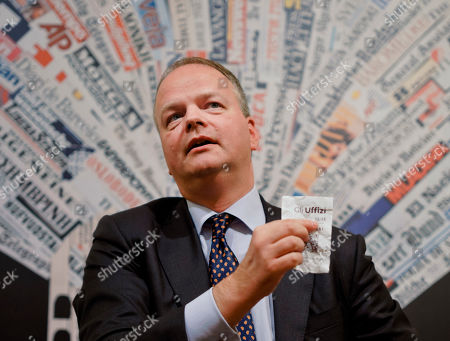 German art historian and director of the Uffizi galleries, Eike Schmidt, shows a ticket for the Uffizi Museum during a press conference at the Foreign Press Club in Rome, . The Uffizi Galleries in Florence aims to discourage visitor overcrowding and ticket scalpers. Schmidt says Italy's most-visited art museum is meeting with Italian privacy guarantors to devise ways to use purchasers' photos to thwart scalpers looking to resell tickets at exorbitant prices