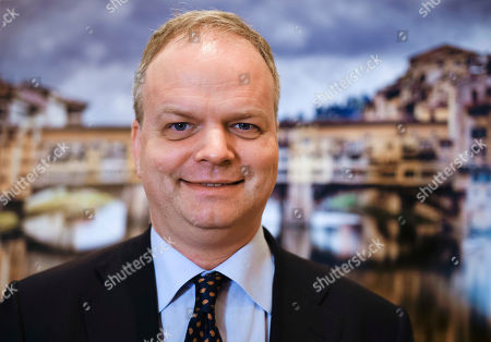 German art historian and director of the Uffizi galleries, Eike Schmidt, poses for portraits before holding a press conference at the Foreign Press Club in Rome, . The Uffizi Galleries in Florence aims to discourage visitor overcrowding and ticket scalpers. Schmidt says Italy's most-visited art museum is meeting with Italian privacy guarantors to devise ways to use purchasers' photos to thwart scalpers looking to resell tickets at exorbitant prices