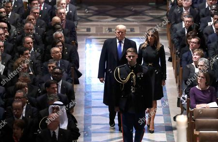 Donald Trump Melania Trump Barack Obama Michelle Obama Bill Clinton Hillary Clinton Jimmy Carter Rosalynn Carter Brian Mulroney Alan Simpson Jon Meacham. President Donald Trump and first lady Melania Trump arrive for the State Funeral former President George H.W. Bush, at the National Cathedral, in Washington