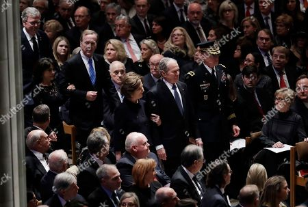 Former President George W. Bush, center, former first lady Laura Bush, Neil Bush, Sharon Bush and Jeb Bush, arrive for the State Funeral for former President George H.W. Bush, at the National Cathedral, in Washington