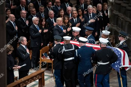 Mike Pence, Karen Pence, Dick Cheney, Dan Quayle, Marilyn Quayle, George W. Bush, Donald Trump, Melania Trump, Rosalynn Carter, Barack Obama, Michelle Obama, Hillare Clinton, Bill Clinton, Jiimmyb Carter. The flag-draped casket of former President George H.W. Bush is carried by a military honor guard past former President George W. Bush, President Donald Trump, first lady Melania Trump, former President Barack Obama, Michelle Obama, former President Bill Clinton, and former Secretary of State Hillary Clinton, at the conclusion of a State Funeral at the National Cathedral, in Washington. In the second row are Vice President Mike Pence, and his wife Karen Pence, former Vice President Dan Quayle, and his wife Marilyn Quayle and former Vice President Dick Cheney