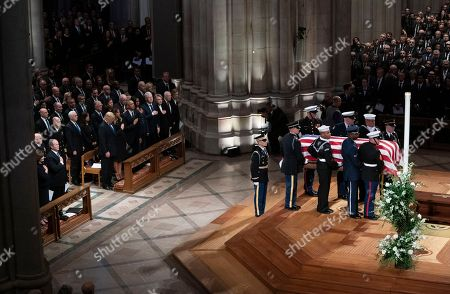 George W. Bush, Laura Bush, Michelle Obama Barack Obama, Jummy Carter Rosalynn Carter, Bill Clinton, Hillary Clinton, Donald Trump Melania Trump. The flag-draped casket of former President George H.W. Bush is carried by a military honor guard past former President George W. Bush and wife Laura Bush, President Donald Trump, first lady Melania Trump, former President Barack Obama, Michelle Obama, former President Bill Clinton, former Secretary of State Hillary Clinton, former President Jimmy Carter, and Rosalynn Carter during a State Funeral at the National Cathedral, in Washington