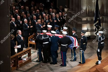 George W. Bush, Donald Trump, Melania Trump, Laura BushRosalynn Carter, Barack Obama, Michelle Obama, Hillare Clinton, Bill Clinton, Jiimmyb Carter. The flag-draped casket of former President George H.W. Bush is carried by a military honor guard past former President George W. Bush and his wife Laura Bush, President Donald Trump, first lady Melania Trump, former President Barack Obama, Michelle Obama, former President Bill Clinton, former Secretary of State Hillary Clinton, former President Jimmy Carter, and Rosalynn Carter at the conclusion of a State Funeral at the National Cathedral, in Washington